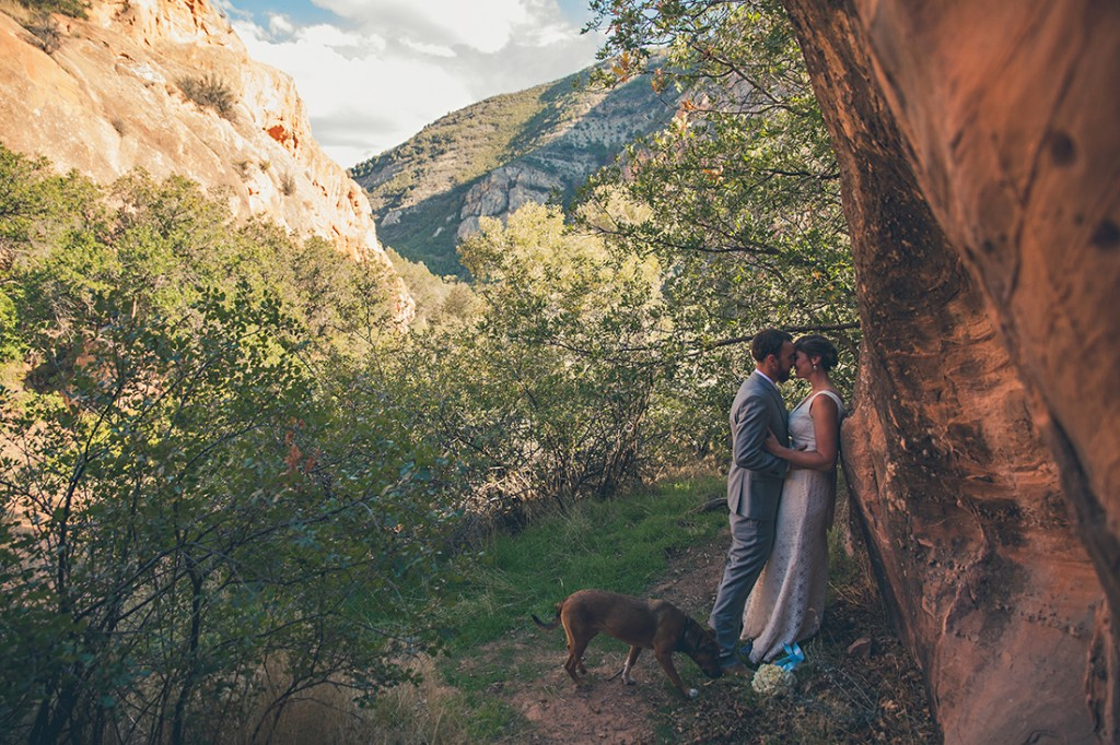 bride and groom kissing by wyoming wedding photographer