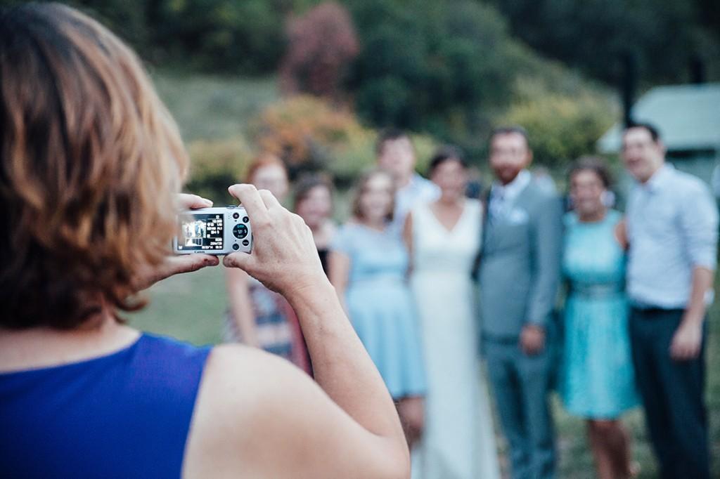 Guests take snapshot at wyoming wedding