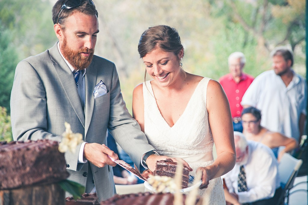 Couple cuts the cake by laramie wyoming wedding photographer
