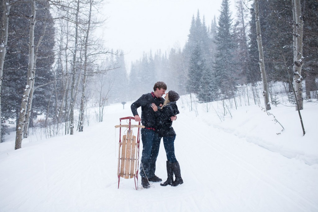 Romantic image of couple during snowstorm in Medicine Bow National Forest