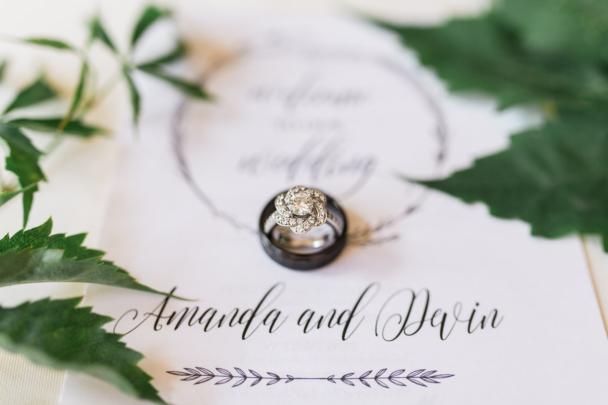 This beautiful program from the Minty Paperie Shop looked perfect along side greenery and Amanda & Devin's wedding rings.