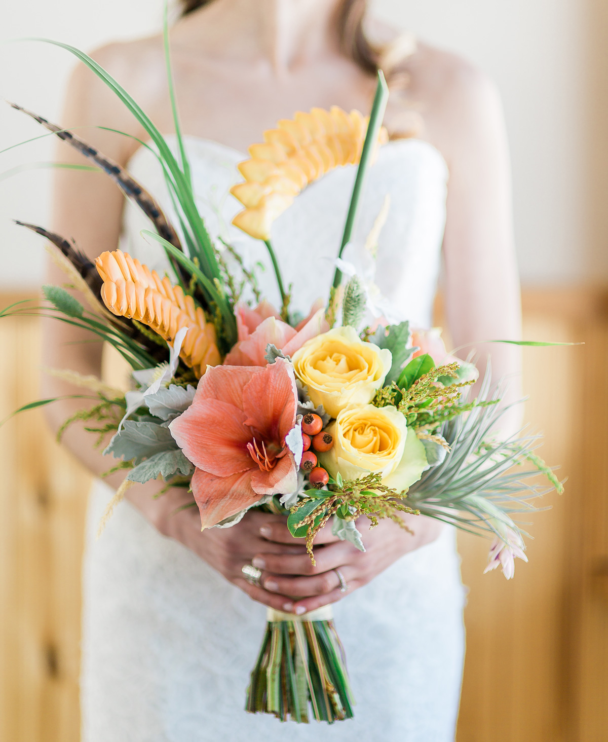 Poppys strikes again with this beautiful tropical bouquet... we love these bright but subdued tones!