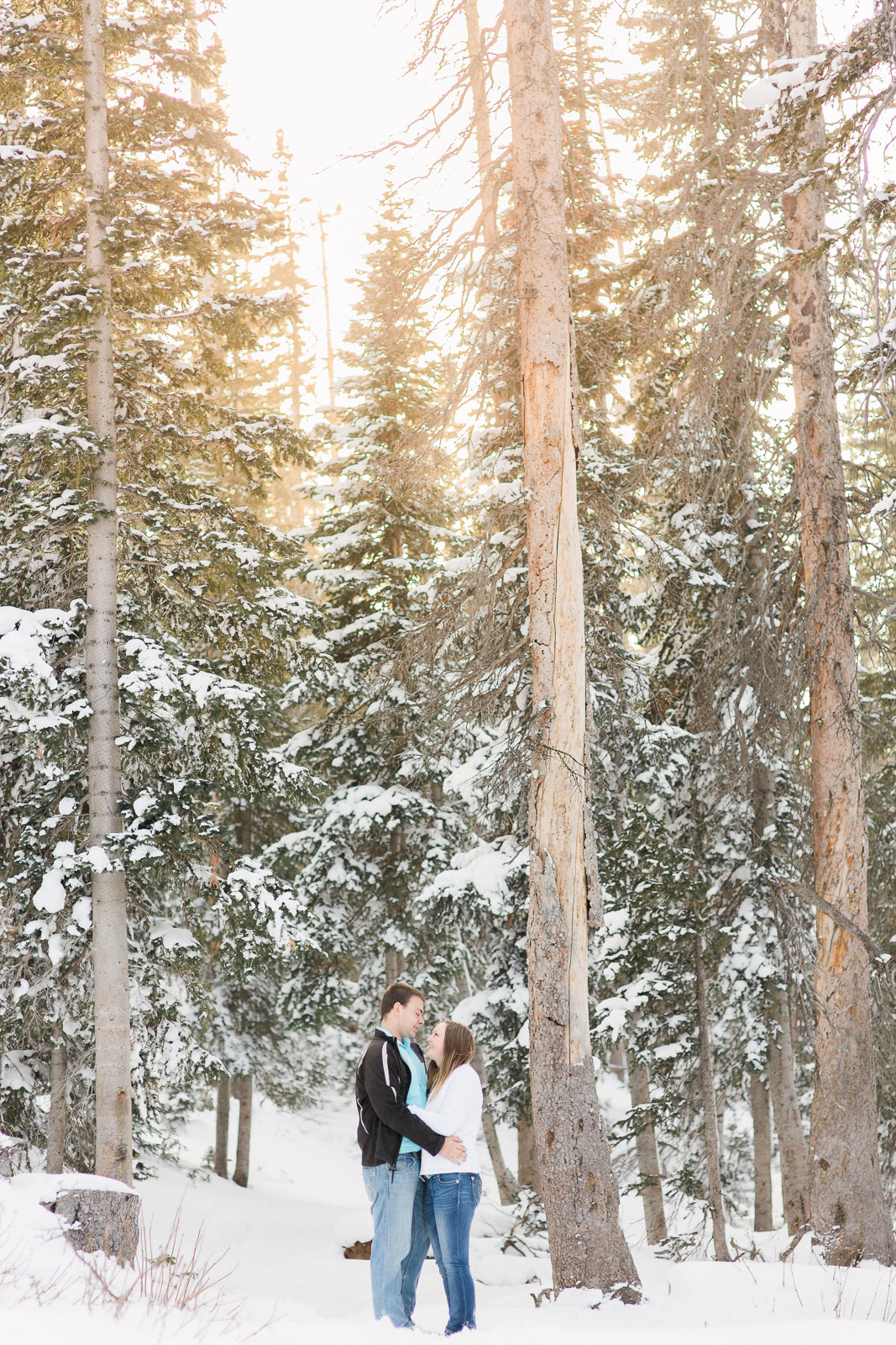 Snowy Range Mountains Wyoming Winter Engagement Photography by Laramie Wyoming Based wedding photographer