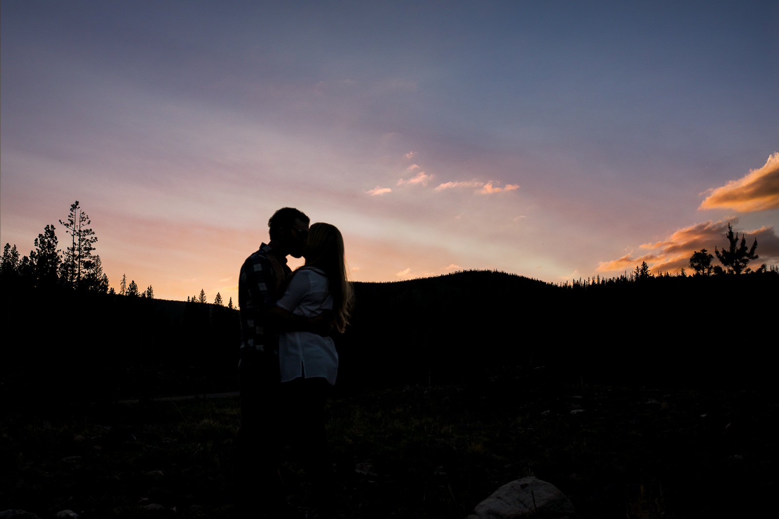 Engagement photography in the mountains of Wyoming by Laramie based photographer. Sunset in Wyoming mountains