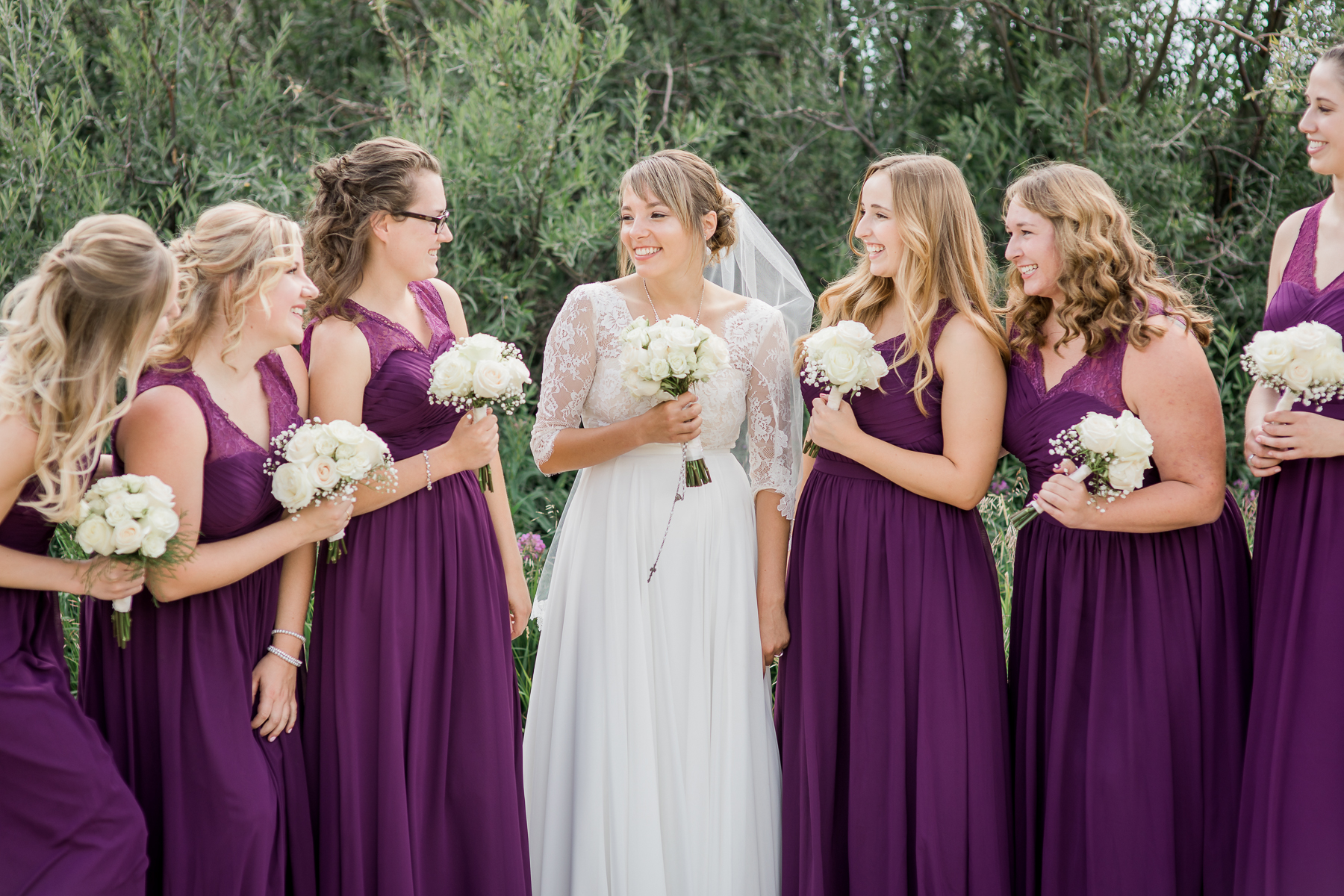 Wyoming wedding with purple floor length bridesmaids gowns