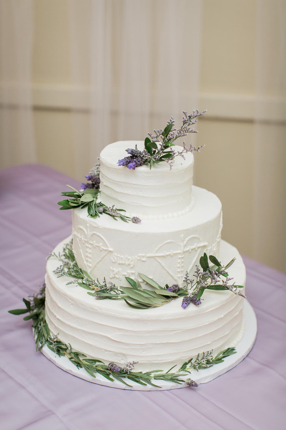 Three-tier white wedding cake