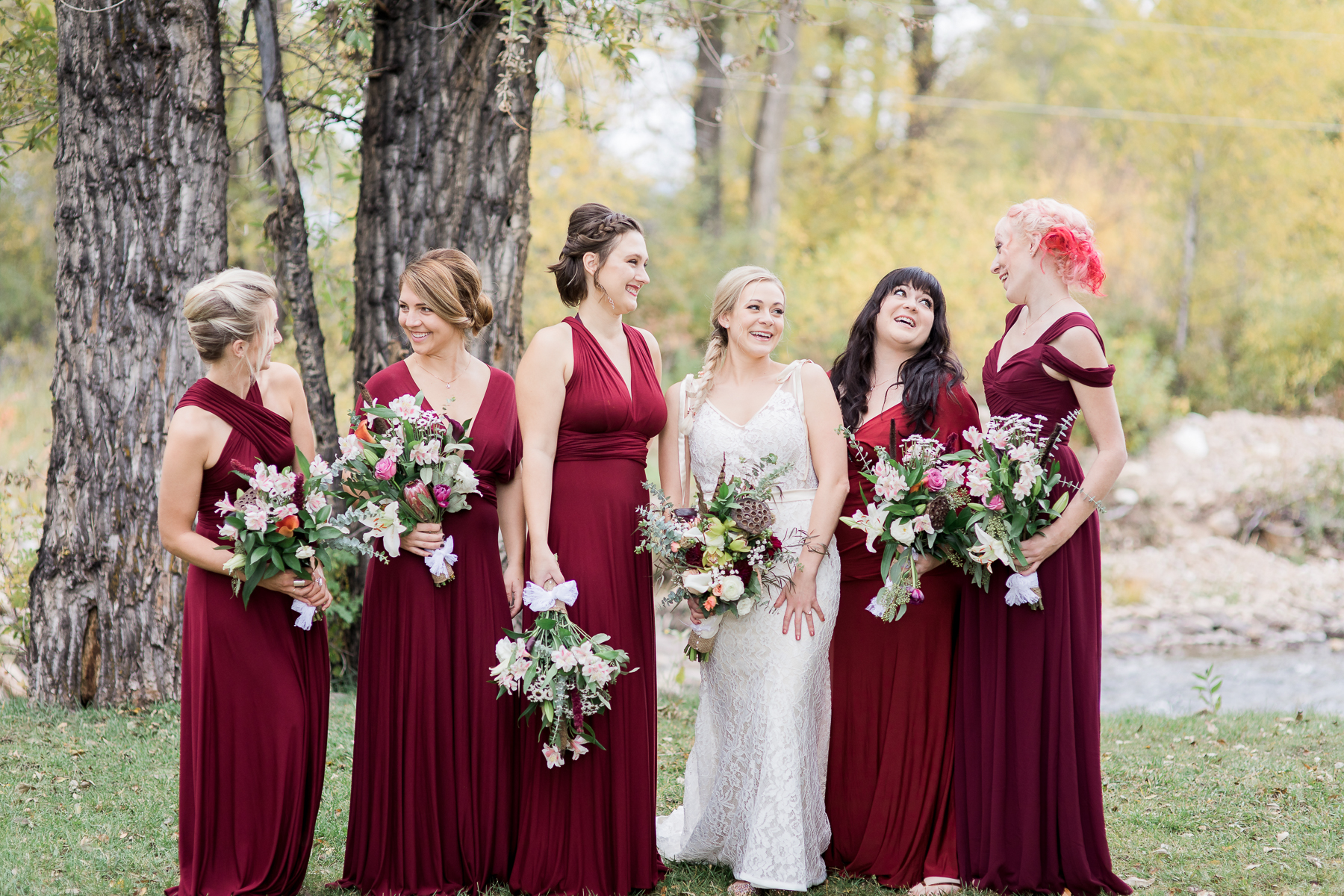 Floor length burgundy bridesmaids gowns