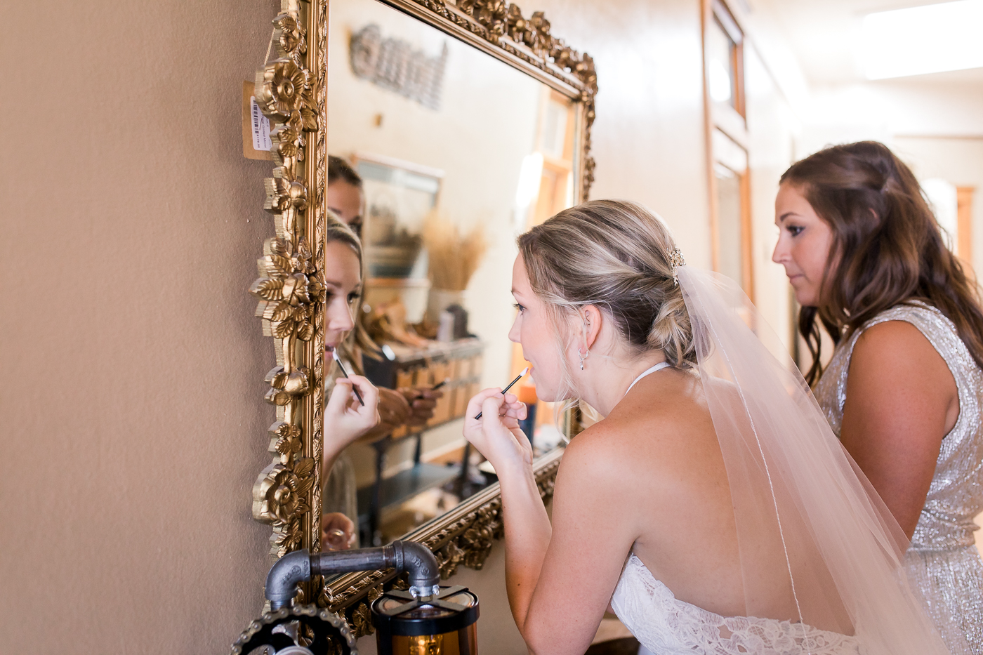 Bride getting ready at Ivinson Mansion wedding in Wyoming